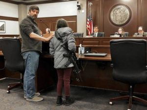 ASSOCIATED PRESS                                 Charles Nielsen, 58, and his 11-year-old granddaughter, Bailey Nielsen, testified before a House panel at the Idaho Statehouse, today, in Boise, Idaho. Visitors to Idaho 18 and older who can legally possess firearms would be allowed to carry a concealed handgun within city limits under legislation that headed to the House today.