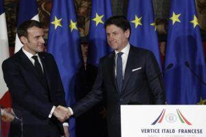 ASSOCIATED PRESS                                 Italian Premier Giuseppe Conte, right, and French President Emmanuel Macron shake hands after a press conference on the occasion of the first French-Italian summit in more than two years, in Naples, southern Italy, today.
