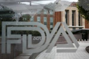 ASSOCIATED PRESS                                 The U.S. Food and Drug Administration building, seen in Aug. 2018, behind FDA logos at a bus stop on the agency's campus in Silver Spring, Md. Health officials reported the first U.S. drug shortage tied to the viral outbreak that is disrupting production in China, but they declined to identify the manufacturer or the product.