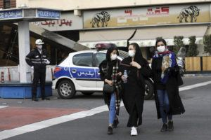 ASSOCIATED PRESS                                 A policeman and pedestrians wear masks to help guard against the coronavirus in Tehran, Iran, on Sunday.