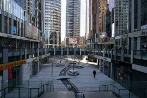 NEW YORK TIMES                                 Sanlitun Soho, a usually busy office complex, is nearly deserted in Beijing on Feb. 1, 2020. The Chinese capital, like other cities far from the epidemic's center, has imposed restrictions and shut down public spaces, straining the ties that bind society.