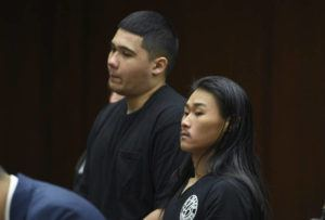 BRUCE ASATO / BASATO@STARADVERTISER.COM                                 Austin Lee, right, and Blaeden Leech, both 20, make their initial court appearances at Honolulu District Court today on charges of attempted murder in connection with Thursday's shooting in Makiki.