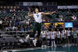 ANDREW LEE / SPECIAL TO THE HONOLULU STAR-ADVERTISER Hawaii's Cole Hogland (7) serves the ball during the second set of an NCAA Men's Volleyball match against Queens today at the Stan Sheriff Center.