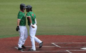 JAMM AQUINO / JAQUINO@STARADVERTISER.COM Hawaii catcher Tyler Murray, left, celebrates with infielder Matt Campos after both scored against the North Dakota State Bison during the third inning.