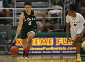 JAMM AQUINO / JAQUINO@STARADVERTISER.COM                                 Hawai'i guard Julissa Tago brings the ball up court ahead of Long Beach State guard Ma'Qhi Berry.