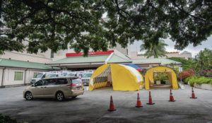 DENNIS ODA / MARCH 12                                 Tents were put up at Queen's Medical Center next to the emergency entrance earlier this month.