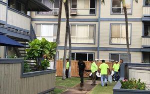 DENNIS ODA / DODA@STARADVERTISER.COM                                 Workers at the Sun Rise townhome complex in Ewa Beach cleaned blood off the sidewalk near the scene of a double-homicide this morning.