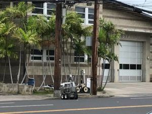 DENNIS ODA / DODA@STARADVERTISER.COM                                 Police use robots this morning to examine a suspicious package near the McCully-Moiliili fire station.