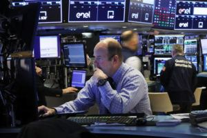 ASSOCIATED PRESS                                 Trader Peter Mancuso prepared for the day's trading, on the floor of the New York Stock Exchange, today.