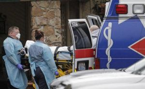 ASSOCIATED PRESS Ambulance workers moved a man on a stretcher from the Life Care Center in Kirkland, Wash. into an ambulance, today. The facility is the epicenter of the outbreak of the the COVID-19 coronavirus in Washington state.