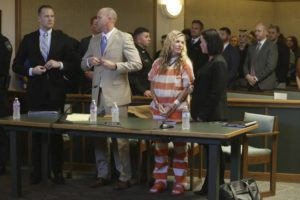 ASSOCIATED PRESS Lori Vallow Daybell, front, second right, and her defense team wait to leave the courtroom during her hearing today in Rexburg, Idaho. Daybell who is charged with felony child abandonment after her two children went missing nearly six months ago had her bond reduced to $1 million by an Idaho judge today.