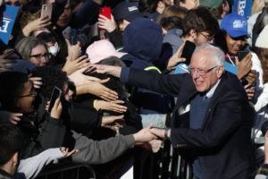 ASSOCIATED PRESS                                 Democratic presidential candidate Sen. Bernie Sanders, I-Vt., works the crowd after speaking at a campaign rally in Chicago's Grant Park on Saturday.