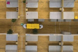 XINHUA VIA AP                                 An aerial view shows staff members cleaning up an empty makeshift hospital in Wuhan, China. The makeshift hospital converted from a sports venue was officially closed on Sunday after its last batch of cured COVID-19 patients were discharged.