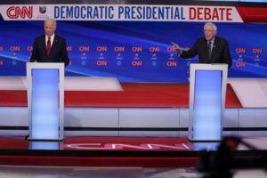 ASSOCIATED PRESS Former Vice President Joe Biden, left, and Sen. Bernie Sanders, I-Vt., right, participate in a Democratic presidential primary debate at CNN Studios in Washington.