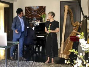 """JORGE PARODI VIA AP From left to right: tenor Piotr Beczala, Metropolitan Opera assistant conductor Howard Watkins (at piano), soprano Joyce DiDonato and Metropolitan Opera Orchestra principal harp Emmanuel Ceysson perform excerpts of Massanet's """"Manon"""" at DiDonato's apartment today in New York. The Metropolitan Opera's performances of """"Manon"""" had been scheduled to open Monday but were canceled because of the coronavirus outbreak."""
