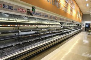 ASSOCIATED PRESS An entire section of meat and poultry is left empty after panicked shoppers swept through in fear of the coronavirus at a local grocery store in Burbank, Calif. on Saturday.
