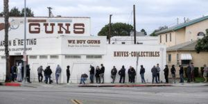 ASSOCIATED PRESS                                 People wait in a line to enter a gun store in Culver City, Calif. on Sunday. Coronavirus concerns have led to consumer panic buying of grocery staples, and now gun stores are seeing a similar run on weapons and ammunition as panic intensifies.