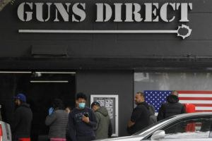 ASSOCIATED PRESS                                 Gun store patrons waited in line, Sunday, in Burbank, Calif. Some people in line simply wanted to stock up on ammunition, while others said they were buying guns for protection in case their homes get invaded for food and other necessities.