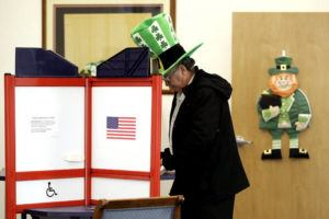 ASSOCIATED PRESS                                 A voter fills out his ballot, taking advantage of early voting on Sunday in Steubenville, Ohio.