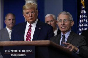 ASSOCIATED PRESS                                 President Donald Trump listens as Director of the National Institute of Allergy and Infectious Diseases Dr. Anthony Fauci speaks during a coronavirus task force briefing at the White House.