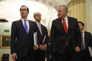 ASSOCIATED PRESS                                 Treasury Secretary Steven Mnuchin, left, accompanied by White House Legislative Affairs Director Eric Ueland and acting White House chief of staff Mark Meadows, spoke with reporters today.