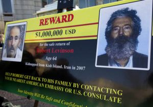 ASSOCIATED PRESS / 2012                                 In this file photo, an FBI poster showing a composite image of former FBI agent Robert Levinson, right, of how he would look like now, left, taken from the video, released by his captors in Washington during a news conference. The family of retired FBI agent Levinson said today that U.S. government officials have concluded that he has died while in the custody of Iran.