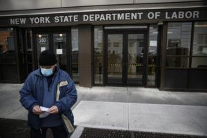 ASSOCIATED PRESS Visitors to the Department of Labor were turned away, March 18, at the door by personnel due to closures over coronavirus concerns. The coronavirus pandemic has already hurt many households financially.
