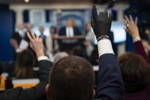 ASSOCIATED PRESS                                 Reporters raise their hands to ask President Donald Trump questions during a press briefing with the coronavirus task force on Monday.