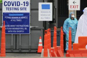 ASSOCIATED PRESS                                 Medical personnel conduct drive-through COVID-19 coronavirus testing at a hospital in Park Ridge, Ill., on March 19.