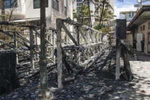 CRAIG T. KOJIMA / FEB. 28                                 A criminal arson investigation is ongoing into the surfboard rack that burned down in Waikiki.