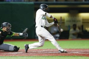 DARRYL OUMI / SPECIAL TO THE HONOLULU STAR-ADVERTISER                                 Hawaii's Scotty Scott (1) makes contact with the ball as he hits into a fielders choice during the game against the Oregon Ducks at Les Murakami Stadium.