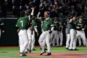 STEVEN ERLER / SPECIAL TO THE STAR-ADVERTISER Hawaii outfielder Scotty Scott (1) celebrated with Matt Campos (7) at homeplate after hitting a grand slam in the 6th inning against the Oregon Ducks on Friday.