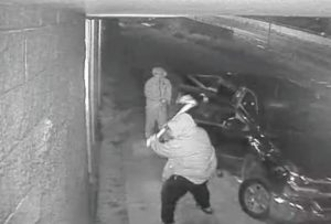 COURTESY HAWAIIAN RENT-ALL                                 This image from a security video shows burglars breaking the window of Hawaiian Rent-All in McCully to steal generators.