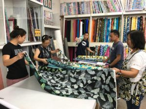 DENNIS ODA / DODA@STARADVERTISER.COM                                 Employees worked to fill online orders at Fabric Mart in Aiea today.