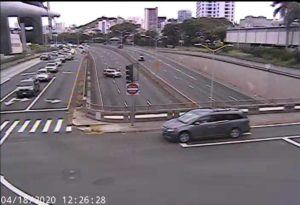 COURTESY HONOLULU.GOV                                 A police car blocks the eastbound lanes of the H-1 freeway this afternoon near Punahou Street.