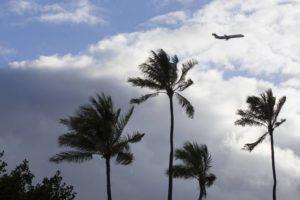 CINDY ELLEN RUSSELL / 2017                                 An airplane is seen is the skies over Magic Island in 2017.