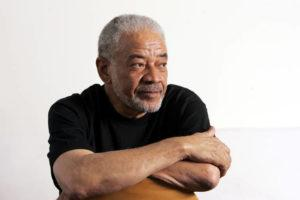 "ASSOCIATED PRESS                                 Singer-songwriter Bill Withers posed in his office, in June 2006, in Beverly Hills, Calif. Withers, who wrote and sang a string of soulful songs in the 1970s that have stood the test of time, including ""Lean On Me,"" ""Lovely Day"" and ""Ain't No Sunshine,"" died in Los Angeles from heart complications on Monday. He was 81."