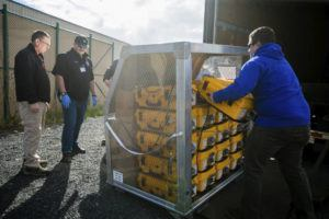 ASSOCIATED PRESS                                 Tony Miller, Yakima County emergency management director; Horace Ward, operations manager of Yakima Valley Office of Emergency Management; and Blake Scully, a resource supply officer, evaluated how many ventilators arrived from the weekly supply shipment on Thursday.