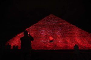 ASSOCIATED PRESS The Ministry of Antiquities lights up the Giza pyramids in an expression of support for health workers battling the coronavirus, in Giza, Egypt. The Egyptian government extended the closure of the country's famed museums and archaeological sites, including the Pyramids and the Sphinx at Giza, until at least April 15.
