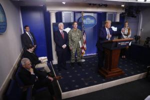 ASSOCIATED PRESS                                 President Donald Trump spoke during a coronavirus task force briefing at the White House, Sunday, in Washington. Dr. Deborah Birx, White House coronavirus response coordinator, right, Navy Rear Adm. John Polowczyk, supply chain task force lead at FEMA, third from right, Vice President Mike Pence, center, and Dr. Anthony Fauci, director of the National Institute of Allergy and Infectious Diseases, left, listened.