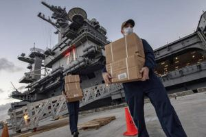 COURTESY U.S. NAVY                                 Sailors assigned to the aircraft carrier USS Theodore Roosevelt move ready to eat meals for sailors who have tested negative for COVID-19 and are being taken to local hotels in an effort to implement social distancing at Naval Base Guam. People in Guam are used to a constant U.S. military presence on the strategic Pacific island, but some are nervous as hundreds of sailors from the coronavirus-stricken Navy aircraft carrier flood into hotels for quarantine. Officials insist they have enforced strict safety measures.