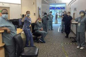 ASSOCIATED PRESS                                 Nurses at Providence Saint John's Health Center in Santa Monica, Calif., Friday, raised their fists in solidarity after telling managers they can't care for COVID-19 patients without N95 respirator masks to protect themselves.
