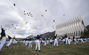 THE GAZETTE VIA AP                                 The class of 2020 toss their caps into the air as the Thunderbirds fly over at the conclusion of the Air Force Academy graduation in Colorado Springs, Colo.