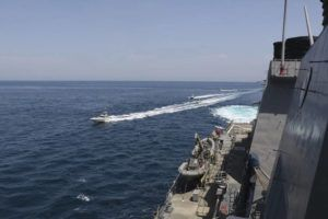 """COURTESY U.S. NAVY                                 In this Wednesday, April 15, 2020, photo, Iranian Revolutionary Guard vessels sail close to U.S. military ships in the Persian Gulf near Kuwait. A group of 11 Iranian naval vessels made """"dangerous and harassing"""" maneuvers near U.S. ships in the Persian Gulf near Kuwait on Wednesday, in one case passing within 10 yards of a U.S. Coast Guard cutter, U.S. officials said."""