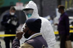 ASSOCIATED PRESS                                 A man swabbed his mouth while taking a COVID-19 test in the Skid Row district Monday in Los Angeles.