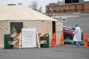 ASSOCIATED PRESS                                 A medic waited outside a tent for her turn to be tested for COVID-19 at Queens Hospital Center, today, in the Jamaica neighborhood of the Queens borough of New York.