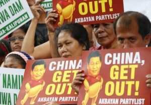 ASSOCIATED PRESS                                 Demonstrators rallied outside the Chinese Consulate, in Nov. 2018, to protest the two-day state visit in the country of President Xi Jinping in Manila. The Philippines, Wednesday, protested China's declaration of a Manila-claimed South China Sea area as part of Chinese territory and the aiming of a weapon on a Philippine navy ship, the country's top diplomat said Wednesday.