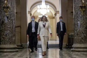 ASSOCIATED PRESS                                 House Speaker Nancy Pelosi of Calif., walks to her office after signing the Paycheck Protection Program and Health Care Enhancement Act, H.R. 266, after it passed the House on Capitol Hill in Washington on April 23.
