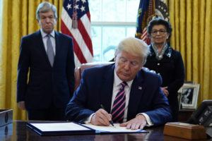 ASSOCIATED PRESS                                 President Donald Trump signs a coronavirus aid package to direct funds to small businesses, hospitals, and testing, in the Oval Office of the White House on April 24 in Washington. Sen. Roy Blunt, R-Mo., left, and Jovita Carranza, administrator of the Small Business Administration look on.