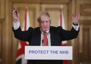 ASSOCIATED PRESS                                 British Prime Minister Boris Johnson gestures during a press briefing at Downing Street in London on March 22. The British prime minister's office says Boris Johnson will return to work Monday, two weeks after he was discharged from a London hospital where he was treated for the new coronavirus.